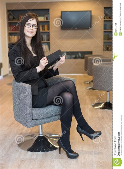 Smiling Business Woman In Glasses Sits On A Chair Stock