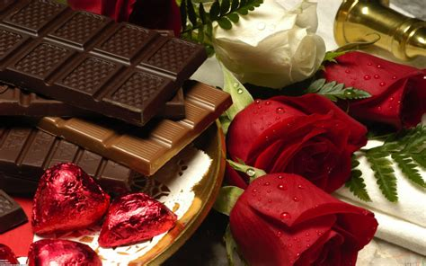 Chocolate hearts and Red roses Symbols of love Wallpaper