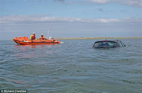 Holy Island tourists 'driving into North Sea' pulled to